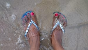 Feet in Sandy Water